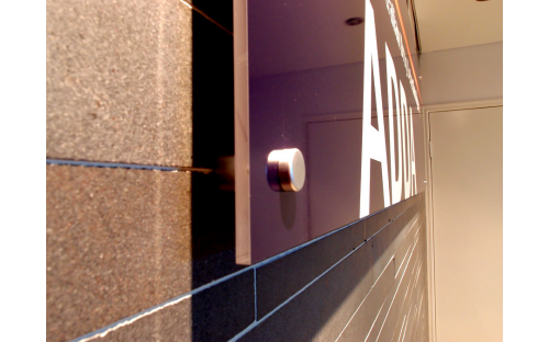 ADDA interior signage on brick wall - quality fixings
