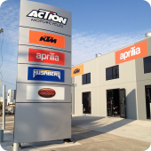 KTM and Aprillia pylon sign and external commercial building signage