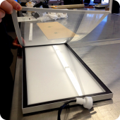 In-house manufacturing and fabrication of light boxes and illuminated signage